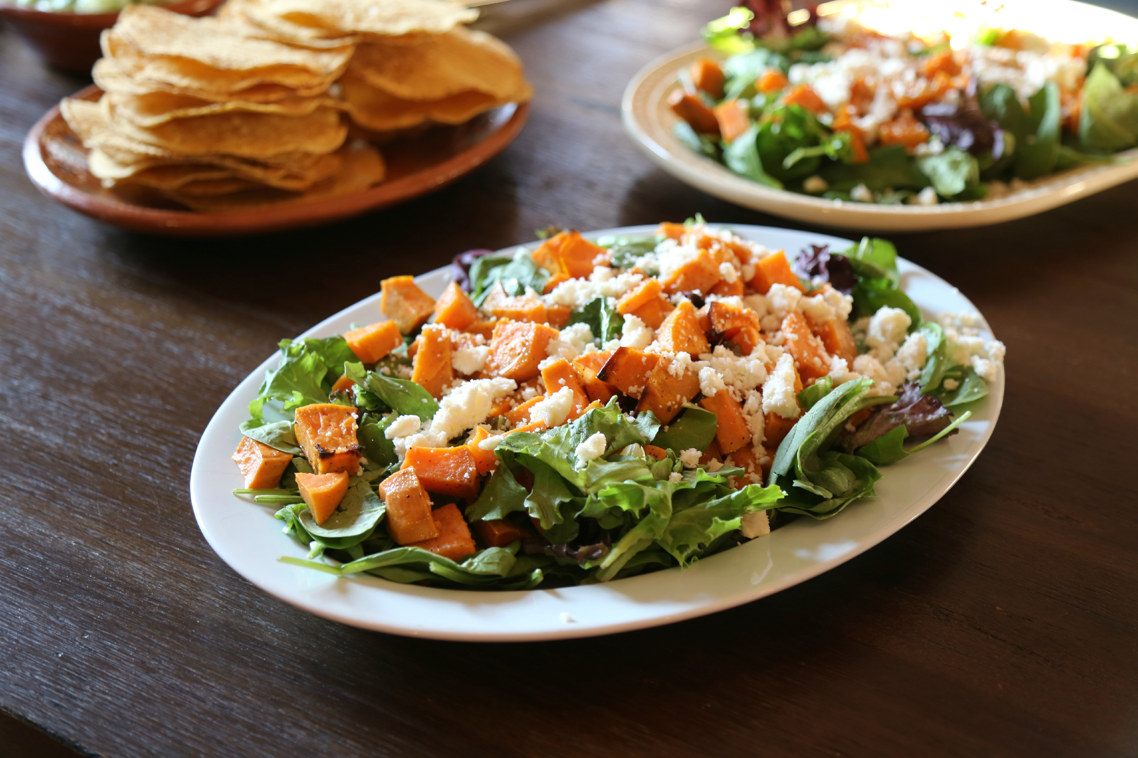 Roasted Sweet-Potato Salad with Hibiscus Lime Dressing - a fall inspired salad made with roasted sweet potatoes served over a bed of mixed greens, topped with queso fresco, pepitas and dressed with hibiscus-lime vinaigrette.