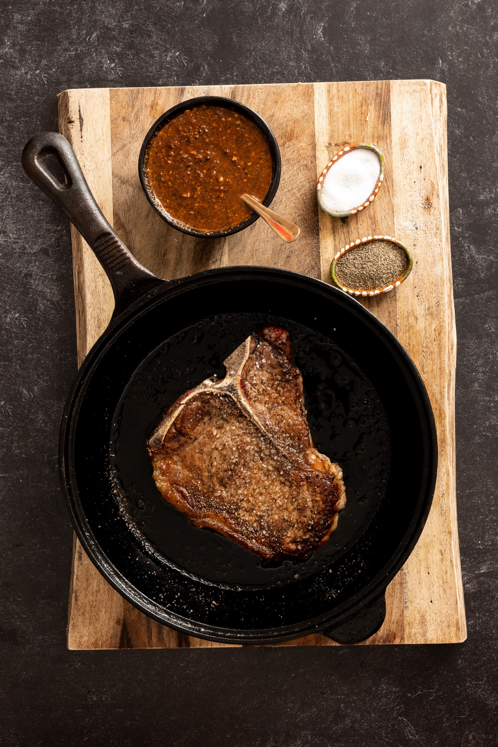 cooking steaks in a cast iron skillet